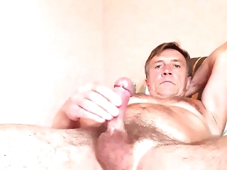 big cock (gay) Guy masturbates in excess of good terms in excess of the couch and cums amateur (gay)